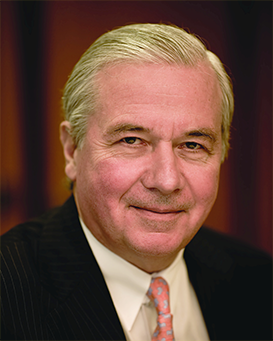 Jean-Paul Montupet, Assurant Board Member, dressed in a suit and tie and looking at the camera