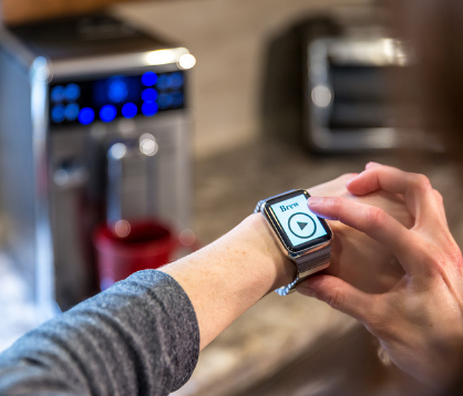person choosing to brew coffee from their smart watch